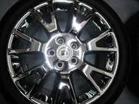 Take off set of chrome wheels and tires from a 2012 Cadillac CTS