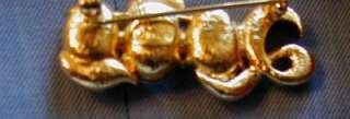 JOAN RIVERS 2000 GOLD TONE AND CLEAR CRYSTAL PIN