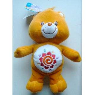 Care Bear Talk N Learn Amigo Bear (Bilingual): Toys & Games