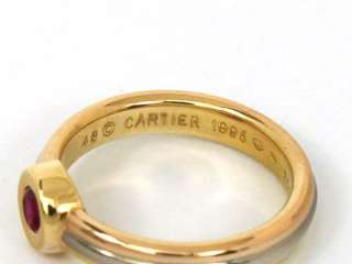 this is a designer cartier tri color 18k gold and ruby