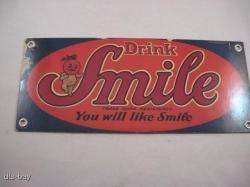 SMALL METAL SMILE SODA POP DRINK ADVERTISING SIGN