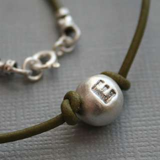 personalised boys initial pebble necklet by green river studio