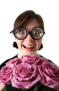 Dorky Girl With Flowers Royalty Free Stock Photo